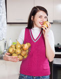 Happy girl with pears Royalty Free Stock Photo