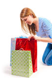 Happy girl peeping in  gift bag Stock Photo