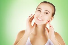 Happy girl with perfect white teeth smile over green backgruond stock photography