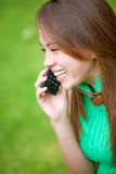 Happy girl on the phone Royalty Free Stock Images