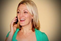 Happy girl on phone Stock Image