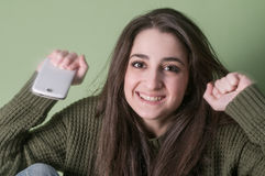 Happy girl with phone Royalty Free Stock Image