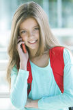 Happy girl on the phone. Happy girl talking with mobile phone Stock Photography