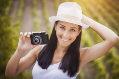 Happy girl photographer with retro camera Stock Photography