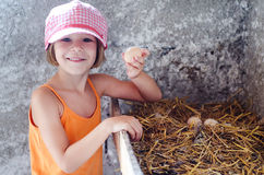 Happy girl picking eggs Royalty Free Stock Photo