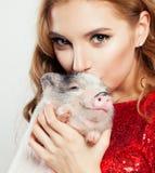 Happy girl and pig, face closeup.  royalty free stock photos