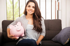 Happy girl with a piggy bank Royalty Free Stock Photo