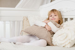 Happy girl with pillow. Stock Photos
