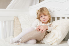 Happy girl with pillow. Royalty Free Stock Photography