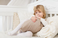 Happy girl with pillow. Stock Image