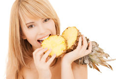 Happy girl with pineapple Stock Photos