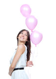 Happy girl with pink balloons Stock Images