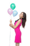 Happy girl with pink balloons Stock Photos