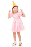 Happy girl in a pink dress and hat dances Stock Photo