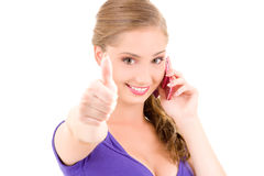 Happy girl with pink phone Stock Photos