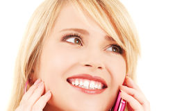 Happy girl with pink phone Royalty Free Stock Image