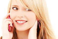 Happy girl with pink phone Stock Image