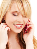 Happy girl with pink phone Royalty Free Stock Images