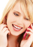 Happy girl with pink phone Royalty Free Stock Photography