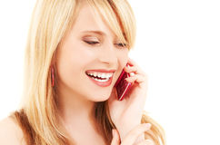 Happy girl with pink phone Royalty Free Stock Photos