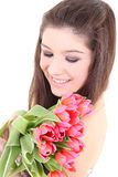 Happy girl with pink tulips Stock Image