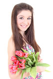 Happy girl with pink tulips Royalty Free Stock Photo
