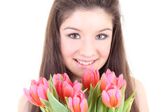 Happy girl with pink tulips Royalty Free Stock Photos