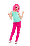 Happy girl in pink wig Stock Photography