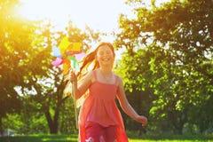 Happy girl with pinwheel toy stock photography
