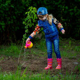 Happy girl planting tree Stock Photos