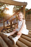 Happy girl in playground Stock Image