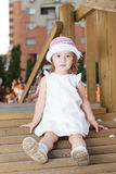 Happy girl in playground. Smiling girl in playground looking at camera Royalty Free Stock Image