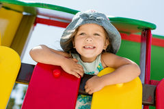 Happy girl on the playground. In summer Royalty Free Stock Photo