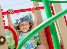 Happy girl on the playground Royalty Free Stock Photo