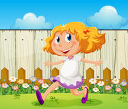 A happy girl playing at the backyard. Illustration of a happy girl playing at the backyard Royalty Free Stock Images