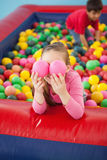 Happy girl playing in ball pool Royalty Free Stock Image
