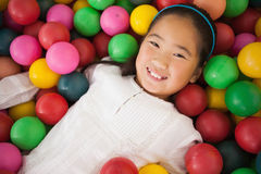 Happy girl playing in ball pool Stock Photos