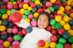 Happy girl playing in ball pool Stock Images