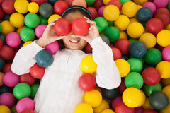 Happy girl playing in ball pool Royalty Free Stock Photography