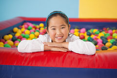 Happy girl playing in ball pool Royalty Free Stock Photos