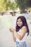 Happy girl playing with balloon Stock Images
