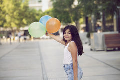 Happy girl playing with balloons Stock Photos
