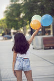 Happy girl playing with balloons Royalty Free Stock Photo