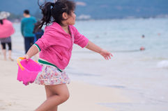Happy girl playing on beach stock photography