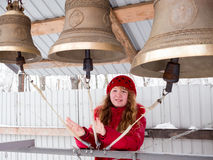 Happy girl playing the bells in winter day Royalty Free Stock Photos