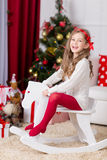 Happy girl playing  in Christmas decorated room Royalty Free Stock Photos