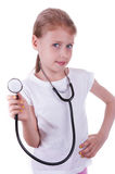 Happy girl playing a doctor Stock Images