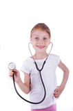 Happy girl playing a doctor Stock Image