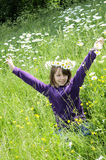 Happy girl playing in field with flowers Royalty Free Stock Photo