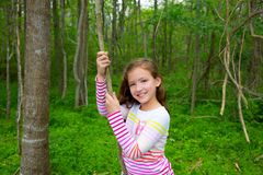 Happy girl playing in forest park jungle with liana Royalty Free Stock Images